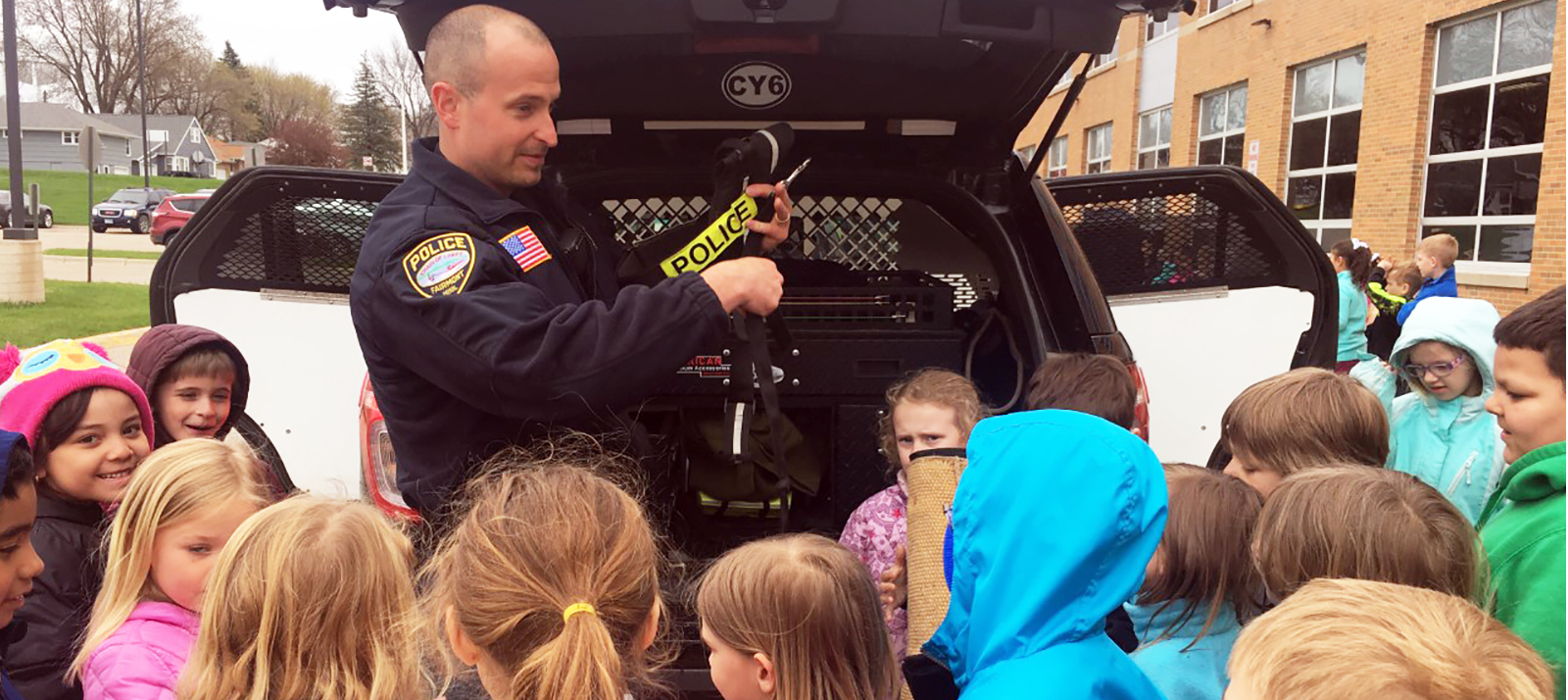 Officer Teaching Elementary Students